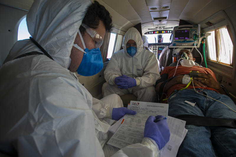 Brazilian COVID-19 positive patient Edinilson Silva, 47, receives medical care on a plane equipped as an ICU unit during the trip from the municipality of Almeirim to the city of Santarem, Para state, Brazil, on July 15, 2020. (Photo by TARSO SARRAF / AFP) (Photo by TARSO SARRAF/AFP via Getty Images)
