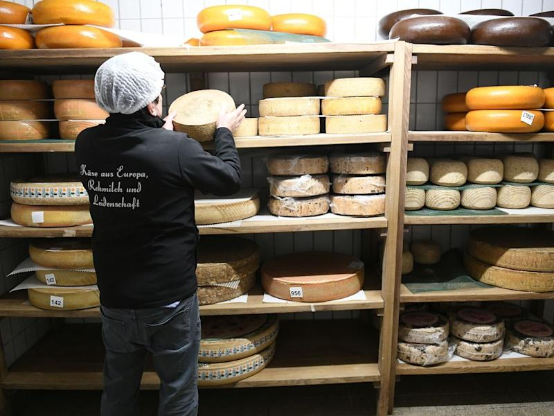 Tölzer Kasladen managing director Wolfgang Hofmann stands in one of the cheese warehouses. | picture alliance/Getty Images