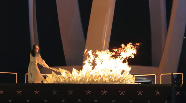 <p>Yuna Kim, former South Korean figure skater lights the Olympic cauldron during the opening ceremony of the 2018 Winter Olympics in Pyeongchang, South Korea, Friday, Feb. 9, 2018. (AP Photo/Julie Jacobson) </p>