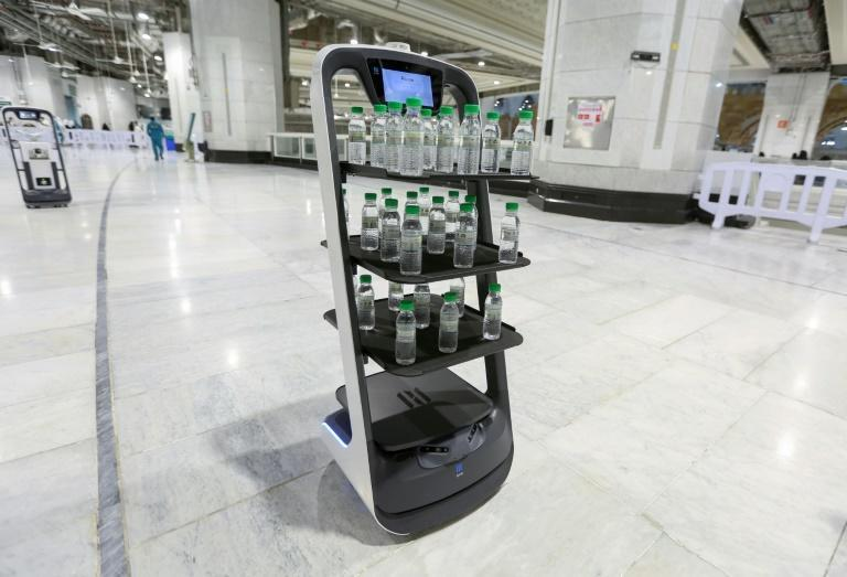 A robot at the Grand Mosque in Saudi Arabia's holy city of Mecca supplies worshippers with bottles of water to reduce direct contact with staff as a measure to prevent Covid infections during the yearly hajj pilgrimage