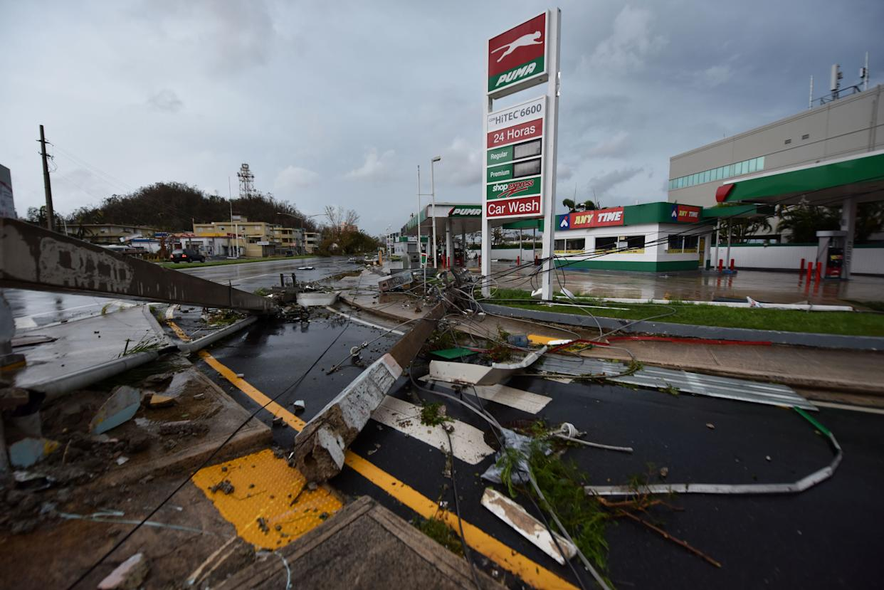 Lightposts lay on the ground after being damaged in San Juan.