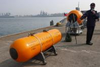A Navy officer introduces a mine during a drill ahead of the Lunar New Year in Kaohsiung,