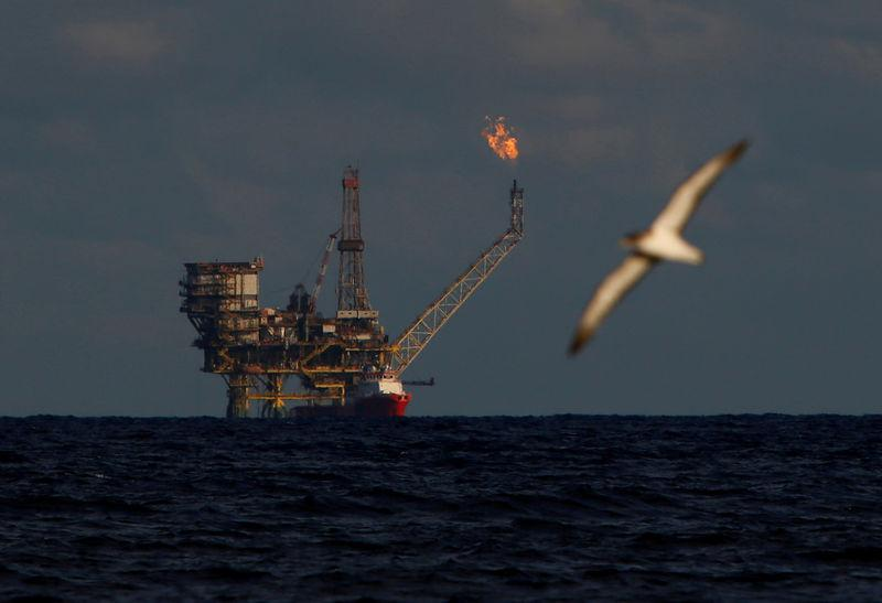 A seagull flies in front of an oil platform in the Bouri Oilfield some 70 nautical miles north of the coast of Libya, October 5, 2017. REUTERS/Darrin Zammit Lupi/Files