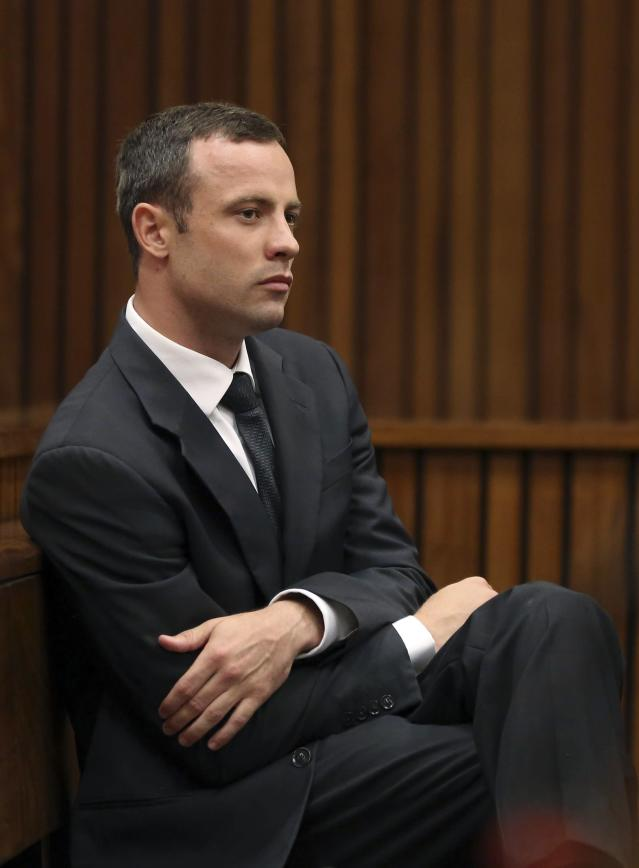 Olympic and Paralympic track star Oscar Pistorius sits in the dock during the fifth day of his trial, for the murder of his girlfriend Reeva Steenkamp, at the North Gauteng High Court in Pretoria March 7, 2014.REUTERS/Themba Hadebe/Pool (SOUTH AFRICA - Tags: SPORT ATHLETICS CRIME LAW)
