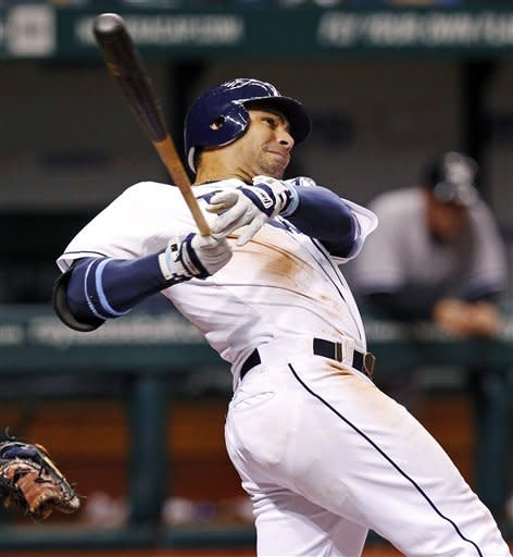 Tampa Bay Rays' Carlos Pena follows through on a two-run home run during the seventh inning of a baseball game against the New York Yankees, Wednesday, July 4, 2012, in St. Petersburg, Fla. (AP Photo/Mike Carlson)