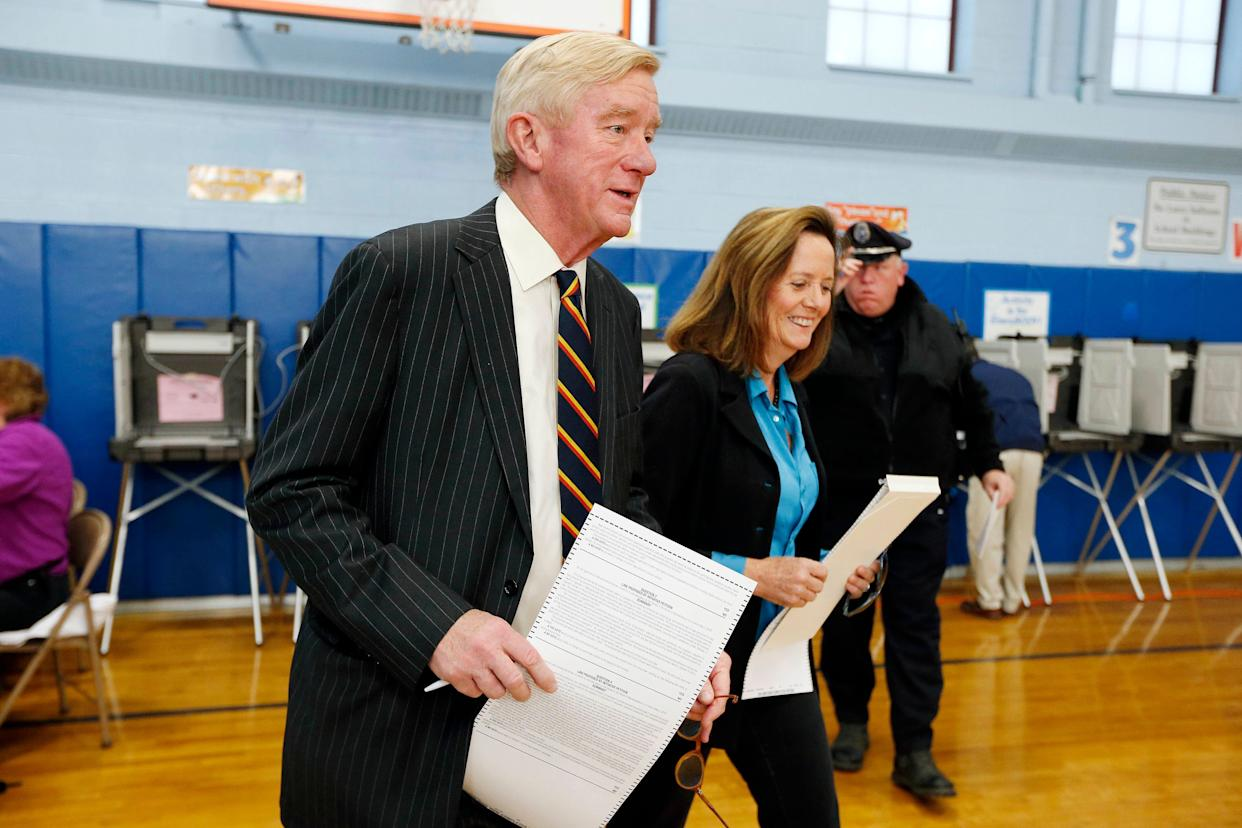 Former Massachusetts Gov. Bill Weld and his wife, Leslie Marshall, hold ballots before casting their votes at the John F. Kennedy Elementary School in Canton, Massachusetts. (Photo: ASSOCIATED PRESS)
