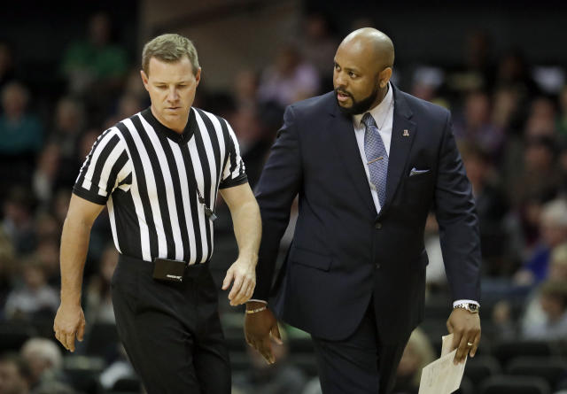 Alcorn State head coach Montez Robinson, right, argues a call in the first half of an NCAA college basketball game against Vanderbilt Friday, Nov. 16, 2018, in Nashville, Tenn. (AP Photo/Mark Humphrey)