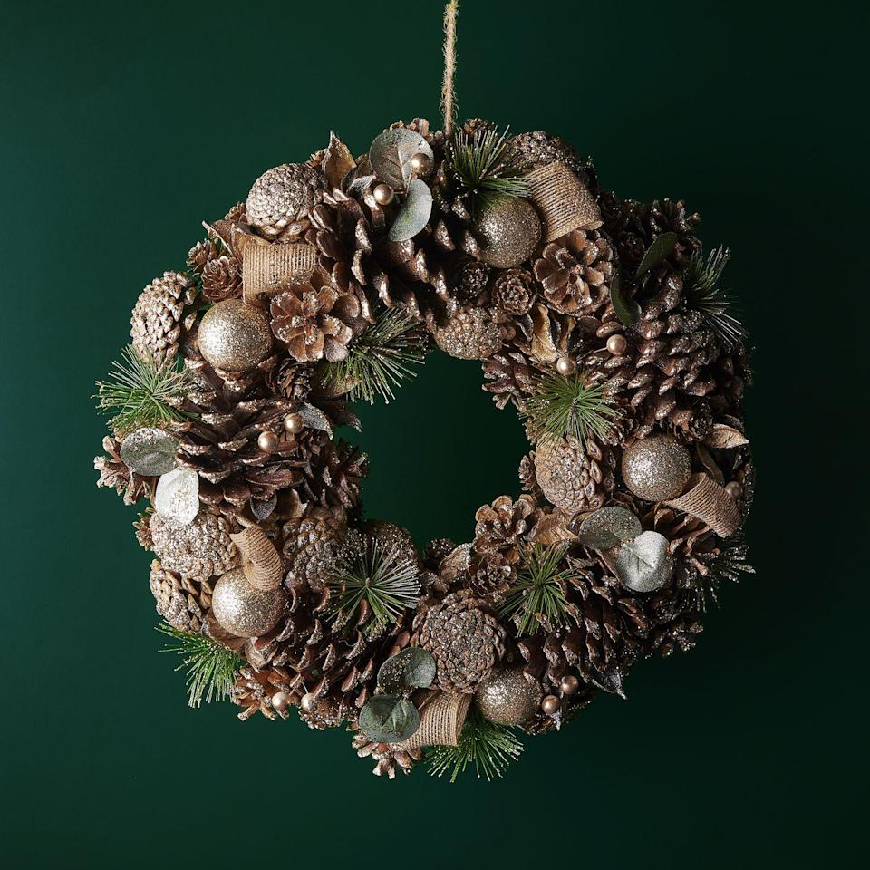 <p>Another wreath being stocked by Waitrose this year is this champagne pinecone wreath. 'Champagne is a hugely popular colour thanks to its soft, neutral tones, with added sparkle just for Christmas,' explain Waitrose.</p>