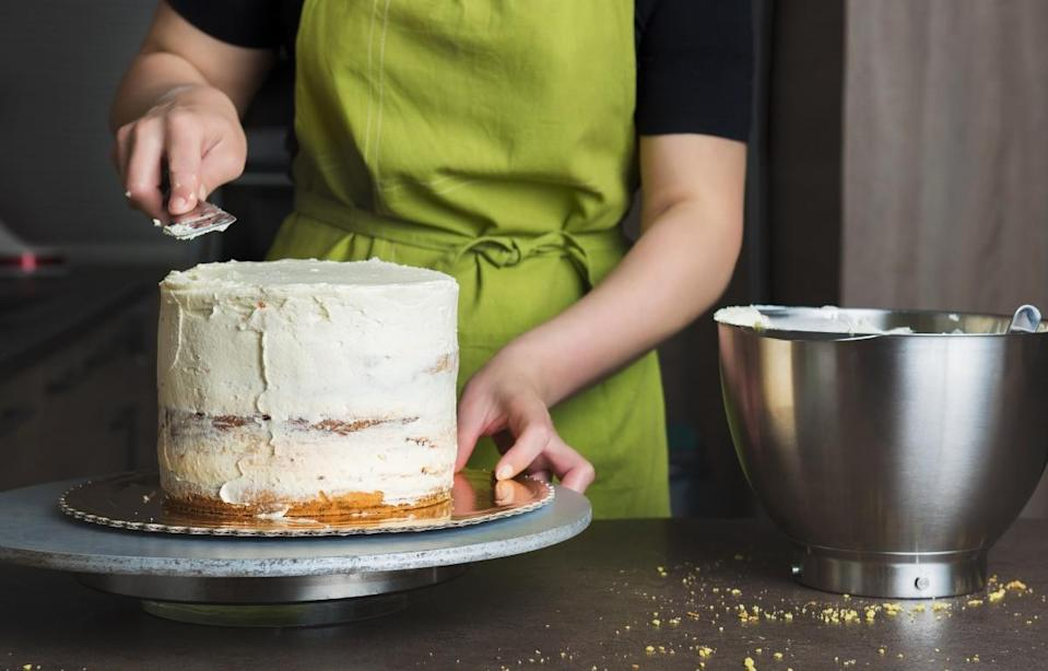 """<p>A baking hack that will give even the <a href=""""https://www.thedailymeal.com/best-dessert-shop-place-america-every-state?referrer=yahoo&category=beauty_food&include_utm=1&utm_medium=referral&utm_source=yahoo&utm_campaign=feed"""" rel=""""nofollow noopener"""" target=""""_blank"""" data-ylk=""""slk:sweetest dessert shop in your area"""" class=""""link rapid-noclick-resp"""">sweetest dessert shop in your area</a> a run for its money is to use a crumb coat. A crumb coat is a thin layer of frosting that's spread over the cake and refrigerated in order to get rid of any crumbs. Once this step is done, you can add another thicker layer of frosting on top.</p>"""