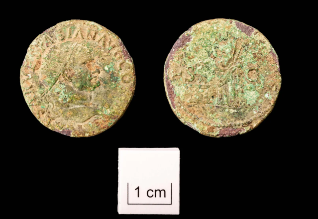 A small coin from the reign of the Emperor Vespasian was also found at the site (Wessex Archaeology)
