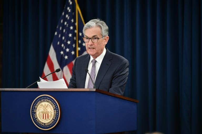 Federal Reserve Chair Jerome Powell says the central bank can address financial risks created by climate change (AFP/MANDEL NGAN)
