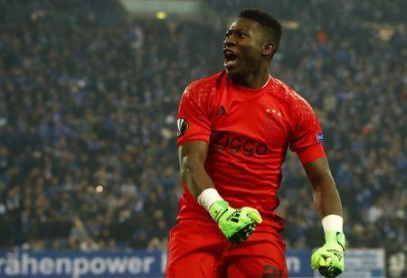Football Soccer - Schalke 04 v Ajax Amsterdam - UEFA Europa League Quarter Final Second Leg - Veltins-Arena, Gelsenkirchen, Germany - 20/4/17 Ajax's Andre Onana celebrates after the match  Reuters / Wolfgang Rattay Livepic