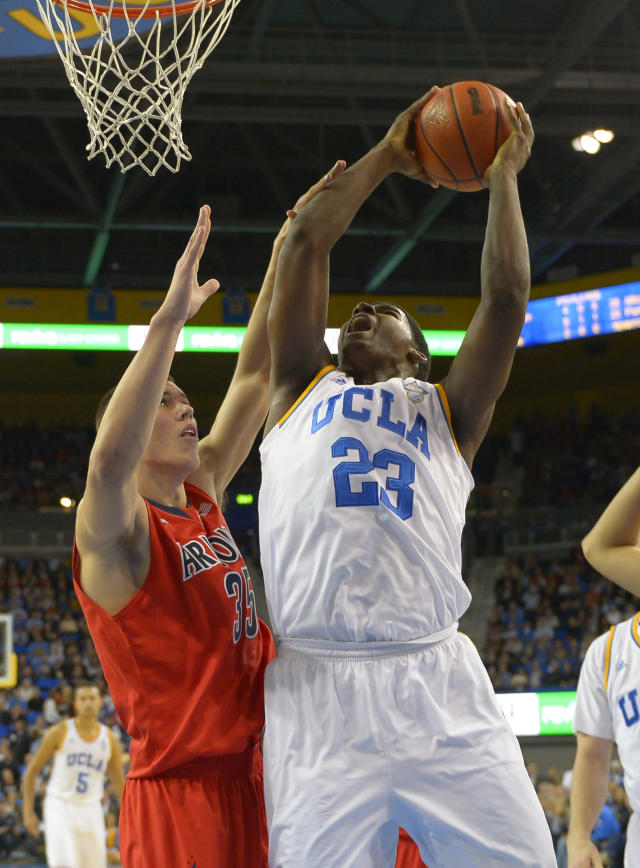 UCLA center Tony Parker, right, shoots as Arizona center Kaleb Tarczewski defends during the first half of an NCAA college basketball game on Thursday, Jan. 9, 2014, in Los Angeles. (AP Photo/Mark J. Terrill)