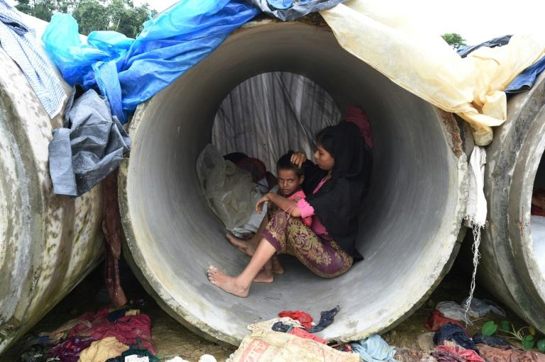 Rohingya Muslim refugees shelter in cement pipes at Kutupalong refugee camp in the Bangladeshi district of Ukhia on September 20, 2017