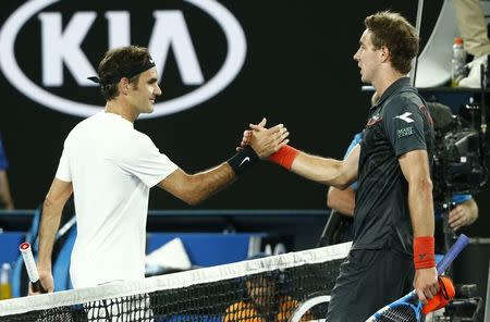 Tennis - Australian Open - Rod Laver Arena, Melbourne, Australia, January 18, 2018. Switzerland's Roger Federer shakes hands with Germany's Jan-Lennard Struff after winning their match. REUTERS/Thomas Peter