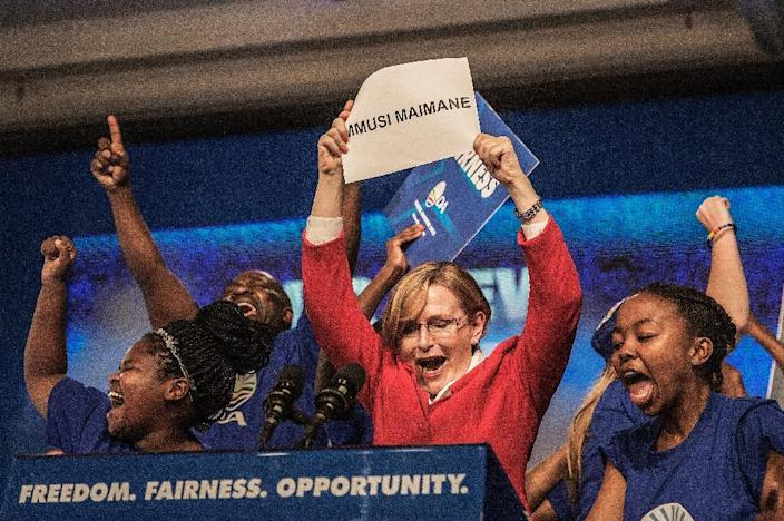 South Africa main opposition party Democratic Alliance outgoing leader Hellen Zille (C) announces the victory of Mmusi Maimane at the end of the vote for her succession, on May 10, 2015 in Port Elizabeth, South Africa (AFP Photo/Gianluigi Guercia)