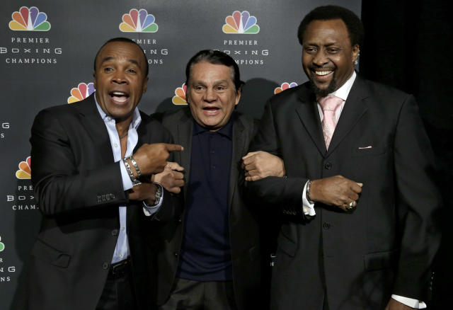Boxing legends Sugar Ray Leonard, left, Roberto Duran, center, and Thomas Hearns joke around while posing for pictures during a news conference in New York, Wednesday, Jan. 14, 2015. NBC plans to air boxing matches on broadcast television beginning with an event on March 7, 2015. (AP Photo/Seth Wenig)
