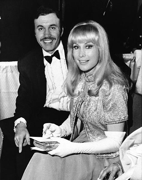 FILE - In this Jan. 21, 1969 file photo, Michael Ansara and Barbara Eden were among several Hollywood couples at the Inaugural Ball in the Sheraton Hotel Ballroom, in Washington. A longtime friend and spokesman for Ansara says the actor died Wednesday, July 31, 2013, at his home in California after a long illness. He was 91. (AP Photo)