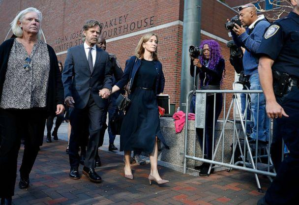 PHOTO: Felicity Huffman leaves federal court with her husband William H. Macy after she was sentenced in a nationwide college admissions bribery scandal, Friday, Sept. 13, 2019, in Boston. (Michael Dwyer/AP)