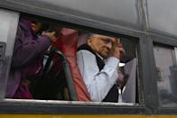 Historian Ramchandra Guha flashes the victory sign from a bus after being taken into custody by police at the Town Hall during a protest held against India's new citizenship law in spite of a curfew in Bangalore on December 19, 2019. - Indians defied bans on assembly on December 19 in cities nationwide as anger swells against a citizenship law seen as discriminatory against Muslims, following days of protests, clashes and riots that have left six dead. (Photo by Manjunath Kiran / AFP) (Photo by MANJUNATH KIRAN/AFP via Getty Images)