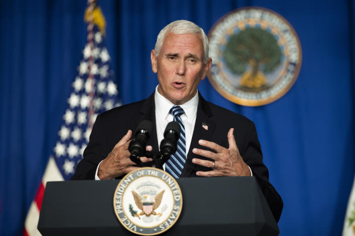 Vice President Mike Pence behind a podium