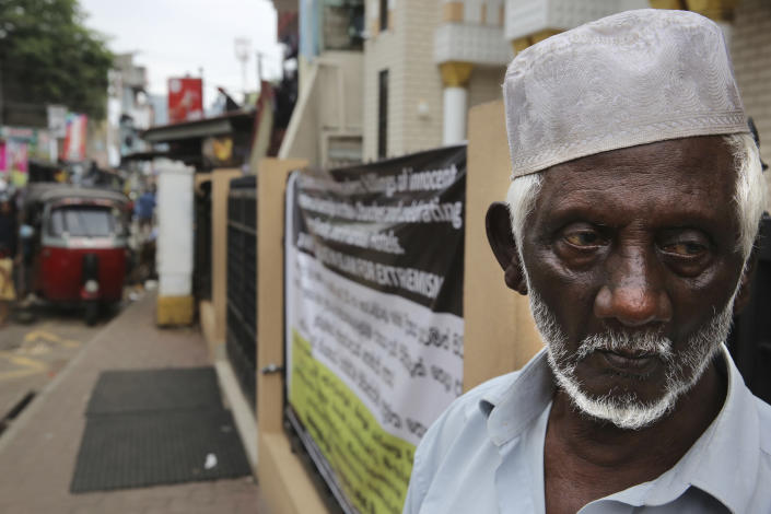 """A Sri Lankan Muslim man waits to offer afternoon prayer in Colombo, Sri Lanka, Monday, April 29, 2019. The Catholic Church in Sri Lanka said Monday that the government should crack down on Islamic extremists with more vigor """"as if on war footing"""" in the aftermath of the Easter bombings. Meanwhile, the government has banned all kinds of face coverings that may conceal people's identities. The emergency law, which took effect Monday, prevents Muslim women from veiling their faces. (AP Photo/Manish Swarup)"""