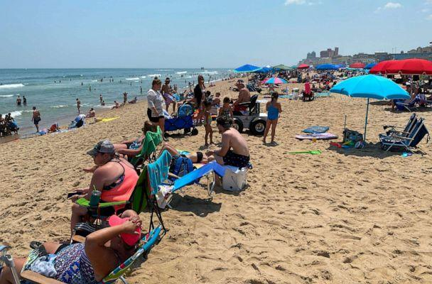 PHOTO: People gather at the beach in Ocean City, Md., on July 3, 2020. (Daniel Slim/AFP via Getty Images)