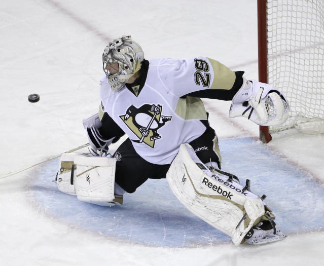 Pittsburgh Penguins goalie Marc-Andre Fleury (29) makes a save during the first period of Game 6 of a second-round NHL playoff hockey series against the New York Rangers, Sunday, May 11, 2014, in New York. (AP Photo/Seth Wenig)