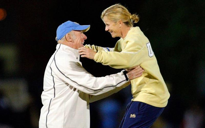 Football-loving father and daughter, John and Jill Ellis celebrate at UCLA