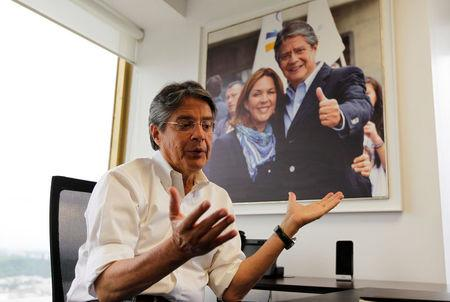 Guillermo Lasso, presidential candidate from the CREO party, talks to Reuters in Guayaquil