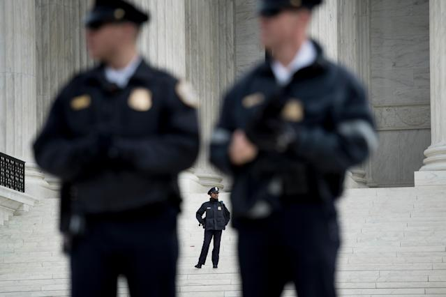 <p>Police guard the outside the US Supreme Court while arguments in the Masterpiece Cakeshop vs. Colorado case are heard Dec. 5, 2017 in Washington. (Photo: Brendan Smialowski/AFP/Getty Images) </p>