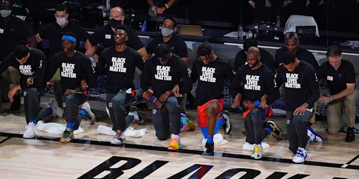 """Oklahoma City Thunder players kneel during the national anthem. <p class=""""copyright"""">Ashley Landis/Pool/USA TODAY Sports/Reuters</p>"""