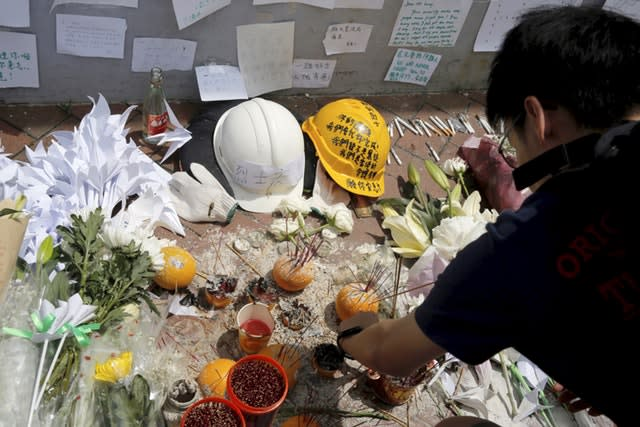 Mourners stop by a makeshift memorial