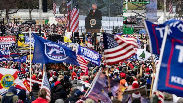 PHOTO: President Donald Trump is seen on a screen as his supporters cheer during a rally Jan. 6, 2021, in Washington, D.C. (Samuel Corum/Getty Images)