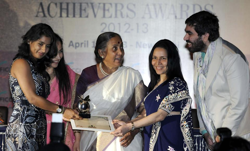 NEW DELHI, INDIA - APRIL 10: Rajasthan Governor Margaret Alva (C) along with YFLO Chairperson Divya Suri Singh (2 L), Zarin Daruwala (2 R) President ICICI Bank present award to Mitali Raj (L) for her contribution in field of Sports as during the FICCI  Ladies Organization Awards 2012-2013 on April 10, 2013 in New Delhi, India. ( Photo By Sonu Mehta/Hindustan Times via Getty Images)