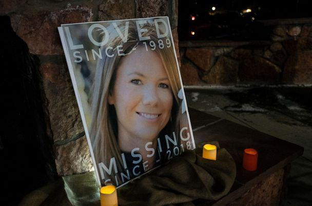 PHOTO: In this Dec. 13, 2018 file photo, a poster with the picture of missing Kelsey Berreth is propped up with candles for a vigil at Memorial Park in Woodland Park, Colo. (Kelsey Brunner/The Gazette via AP)