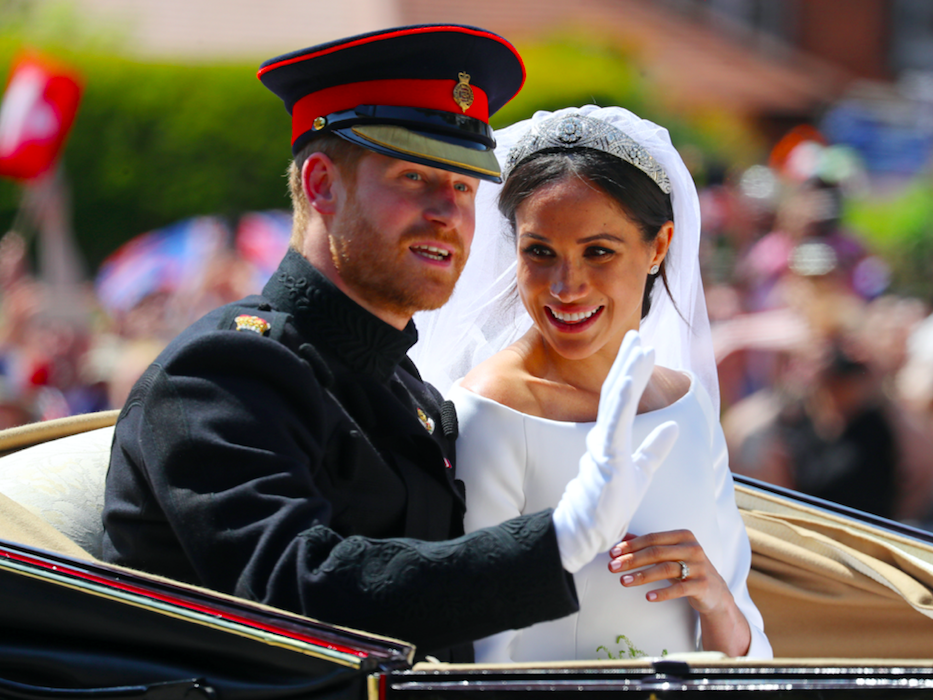 <em>The couple waved to crowds in a procession following their wedding (Rex)</em>