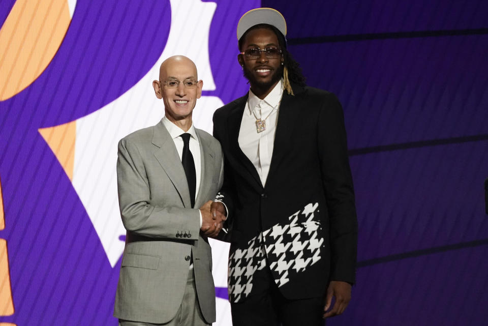 Isaiah Jackson,right, poses for a photo with NBA Commissioner Adam Silver after being selected 22nd overall by the Los Angeles Lakers during the NBA basketball draft, Thursday, July 29, 2021, in New York. (AP Photo/Corey Sipkin)
