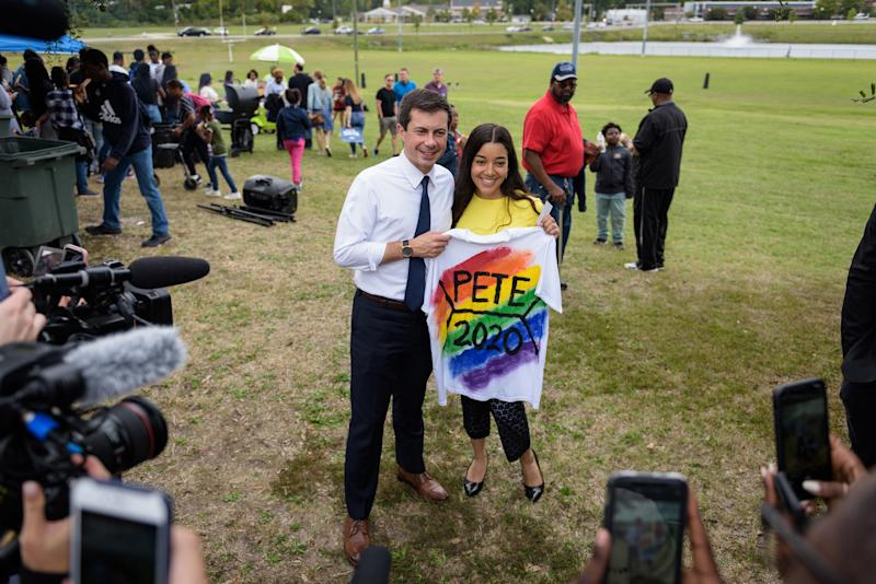 Mayor Pete Buttigieg of South Bend, Ind. poses for a photo with Kashmir Imani, holding a T-shirt she designed, during a homecoming tailgate event at Allen University, a historically black campus in Columbia, S.C., on Oct. 26, 2019. | Bryan Cereijo—The New York Times/Redux