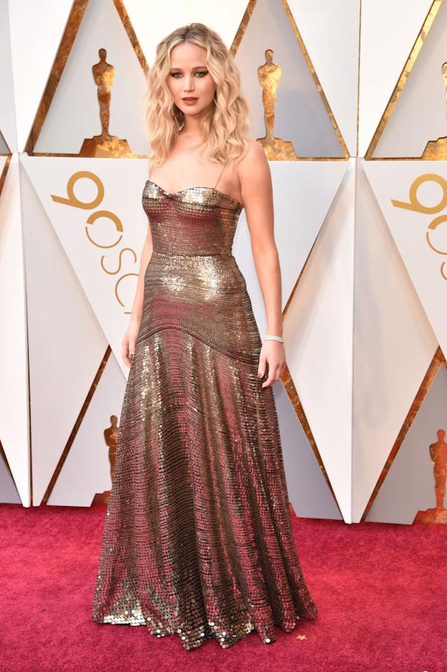 <p><i>Mother!</i> star Jennifer Lawrence selected a design from Dior for her evening at the Oscars that mimicked the Oscar award itself. (Photo: Getty Images) </p>