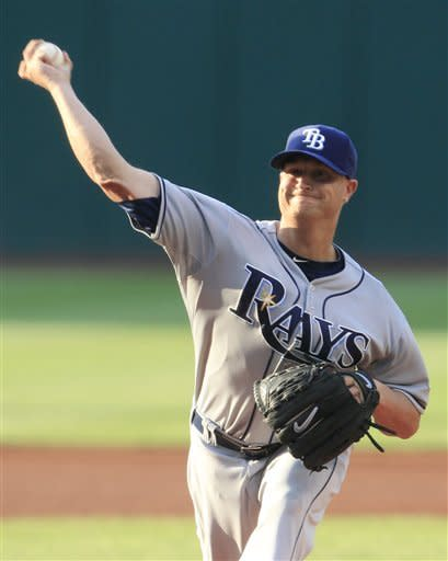Tampa Bay Rays starting pitcher Alex Cobb delivers against the Cleveland Indians during the first inning of a baseball game, Friday, July 6, 2012, in Cleveland. (AP Photo/Tony Dejak)