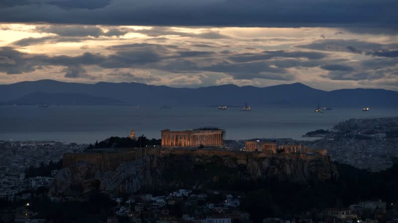 FILE PHOTO: The Parthenon temple is seen atop the Acropolis hill at dusk, in Athens