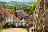 """<p>Next on the list is technically a small town, but it's so picturesque that we had to include it. You might recognise Shaftesbury's most famous cobbled lane, Gold Hill, from the iconic Hovis bread advert in the 1970s. </p><p>As one of England's highest towns (it's more than 750 feet above sea level), it's a great place to come for sweeping views of beautiful Blackmore Vale AONB. Plus you'll find lots of great cafés, pubs and quirky shops on the bustling high street.</p><p><strong>Where to stay: </strong><a href=""""https://go.redirectingat.com?id=127X1599956&url=https%3A%2F%2Fwww.booking.com%2Fhotel%2Fgb%2Fgrosvenor-shaftesbury.en-gb.html%3Faid%3D2070936%26label%3Ddorset-villages&sref=https%3A%2F%2Fwww.prima.co.uk%2Ftravel%2Fg35967807%2Fdorset-villages%2F"""" rel=""""nofollow noopener"""" target=""""_blank"""" data-ylk=""""slk:The Grosvenor Arms"""" class=""""link rapid-noclick-resp"""">The Grosvenor Arms</a> is a smart Georgian hotel in the centre of Shaftesbury with a comfy bar and restaurant, and a peaceful courtyard for outdoor dining. </p><p><a class=""""link rapid-noclick-resp"""" href=""""https://go.redirectingat.com?id=127X1599956&url=https%3A%2F%2Fwww.booking.com%2Fhotel%2Fgb%2Fgrosvenor-shaftesbury.en-gb.html%3Faid%3D2070936%26label%3Ddorset-villages&sref=https%3A%2F%2Fwww.prima.co.uk%2Ftravel%2Fg35967807%2Fdorset-villages%2F"""" rel=""""nofollow noopener"""" target=""""_blank"""" data-ylk=""""slk:CHECK AVAILABILITY"""">CHECK AVAILABILITY</a></p>"""