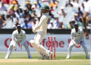 Australia's Nathan Lyon lets a ball pass during play on day four of the second cricket test between India and Australia at the Melbourne Cricket Ground, Melbourne, Australia, Tuesday, Dec. 29, 2020. (AP Photo/Asanka Brendon Ratnayake)