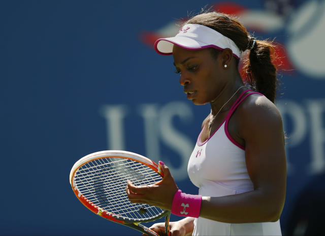 Sloane Stephens, of the United States, adjusts the strings on her racket between points against Johanna Larsson, of Sweden, during the second round of the 2014 U.S. Open tennis tournament, Wednesday, Aug. 27, 2014, in New York. (AP Photo/Matt Rourke)