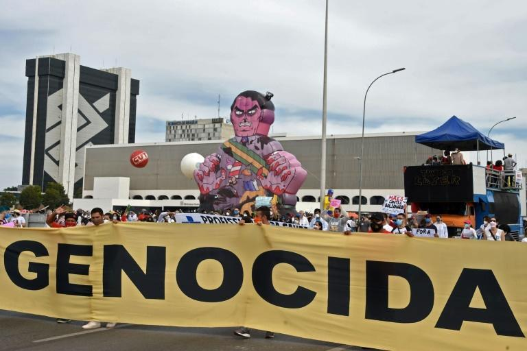 Members of opposition parties and social movements participate in a protest against Brazilian President Jair Bolsonaro's handling of the COVID-19 pandemic