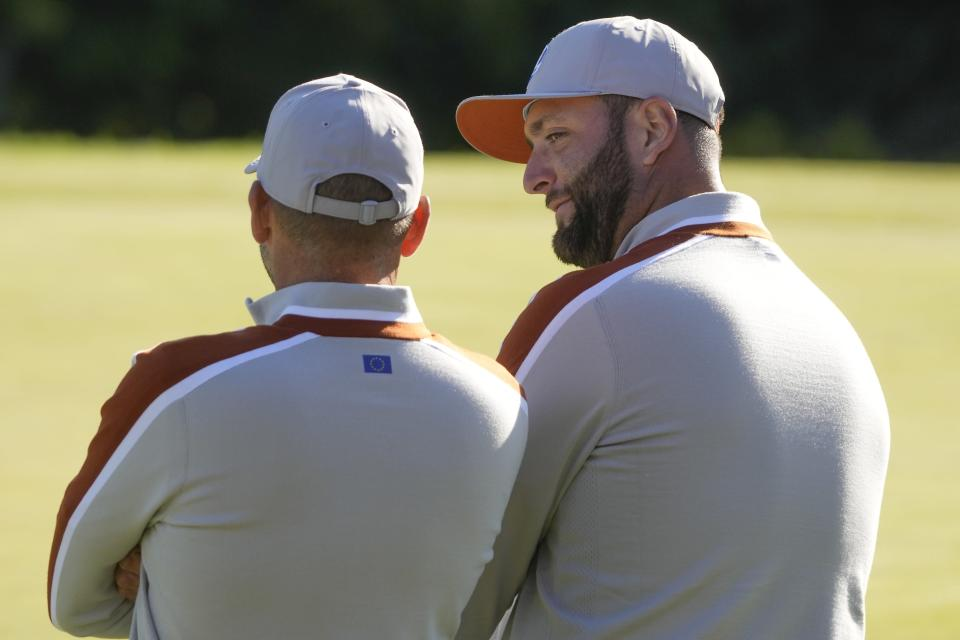 Team Europe's Jon Rahm talks to Team Europe's Sergio Garcia on the ninth hole during a foursomes match the Ryder Cup at the Whistling Straits Golf Course Saturday, Sept. 25, 2021, in Sheboygan, Wis. (AP Photo/Charlie Neibergall)