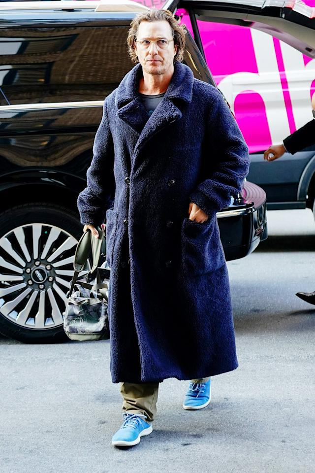 Matthew McConaughey stays toasty in a fuzzy blue coat and coordinating blue sneakers in New York City on Friday.