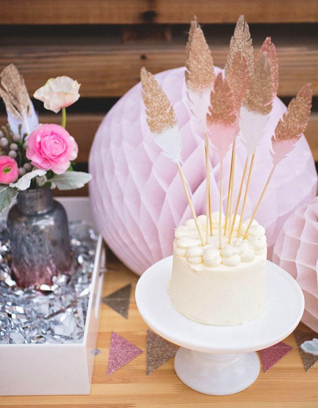 """<p>For an unconventional twist on New Year's Eve decor, this party from <a rel=""""nofollow noopener"""" href=""""https://greenweddingshoes.com/southwestern-bohemian-new-years-eve-inspiration/"""" target=""""_blank"""" data-ylk=""""slk:Green Wedding Shoes"""" class=""""link rapid-noclick-resp"""">Green Wedding Shoes</a> features feathers dipped in shimmering metallic paint and shades of rose-petal pink - a perfectly chic (and Insta-friendly) combination. </p>"""