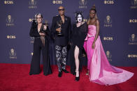 """Michelle Visage, from left, RuPaul Charles, Gottmik, and Symone pose for a photo with the award for outstanding competition program for """"RuPaul's Drag Race"""" at the 73rd Primetime Emmy Awards on Sunday, Sept. 19, 2021, at L.A. Live in Los Angeles. (AP Photo/Chris Pizzello)"""